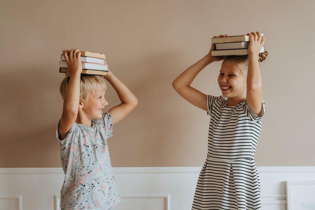 Children dance with books
